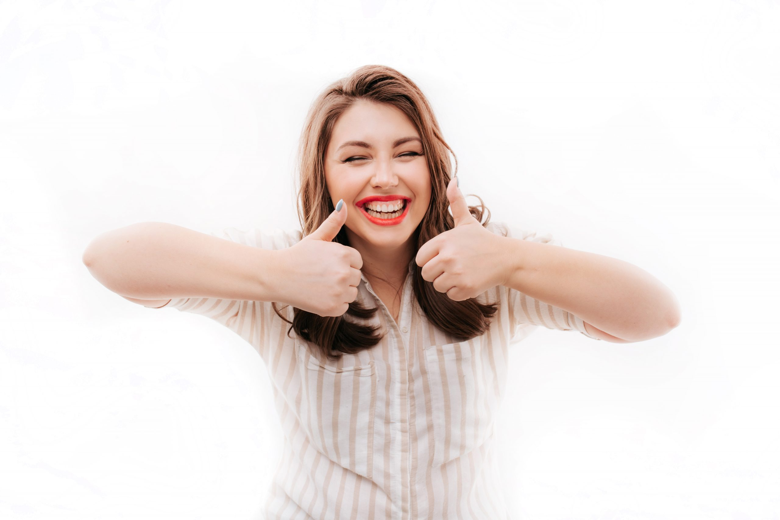 Excited plus size model gesturing thumb ups